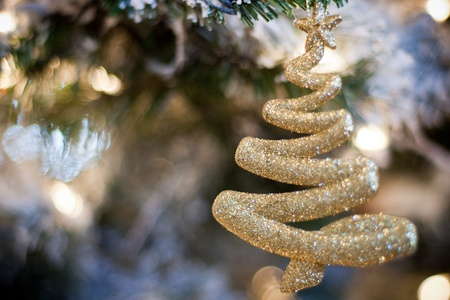 sparkling gold christmas tree ornament hanging on christmas tree Stock Photo