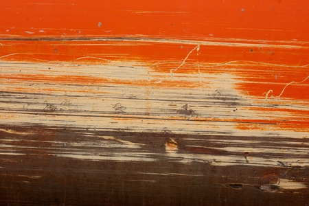 orange and tan scraping on construction equipment