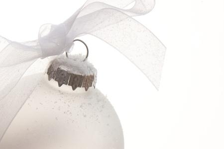 white christmas ornament hanging on a christmas tree Stock Photo