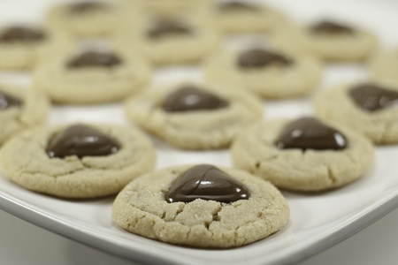 peanut butter cookies with chocolate heart in center for valentines