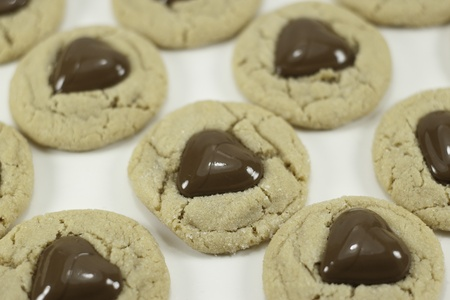 heart shaped chocolate on peanut butter cookies with a white background