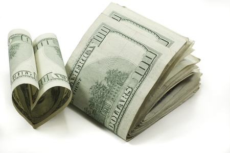 love of money stack of folded 100 dollar bills one shaped like a heart Stock Photo