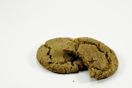 two ginger snap cookies with bite Stock Photo