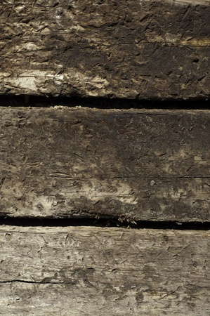 three stacked railroad ties in portrait position for texture or background