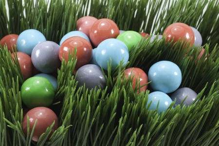 candy gumballs in grass for holiday or easter and springtime Stock Photo