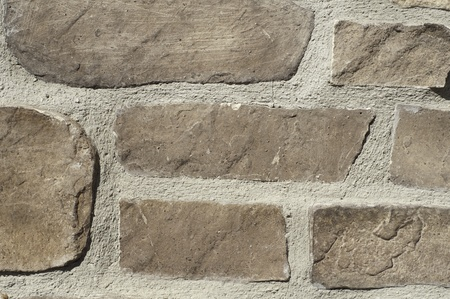 rock and mortar background found on the exterior of houses or buildings photo