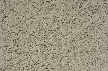 tan stucco texture for background usually found on a house or other building Stock Photo