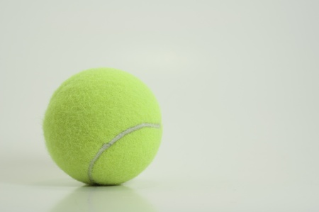 bright green new tennis ball isolated on white background Stock Photo