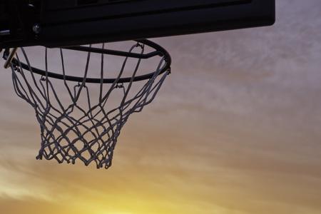 basketball hoop silhouette sunset