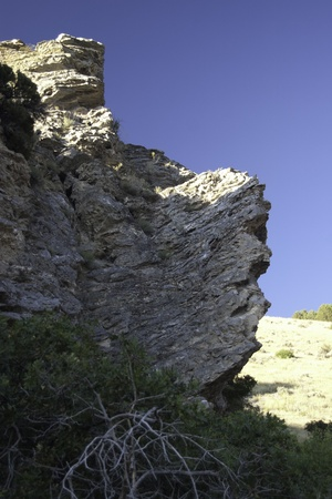 large rock cliffs in American Fork Canyon, Utah viewed from below