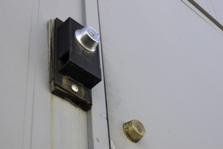 double dead bolt locks on a door of a building for security