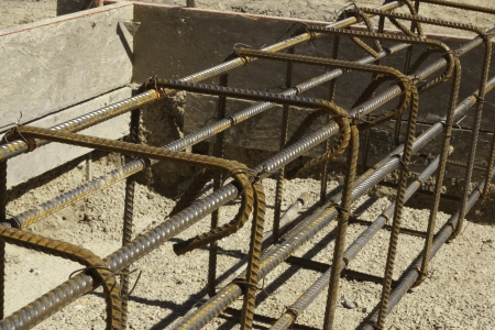 rebar and forms tied for concrete in construction in daylight photo