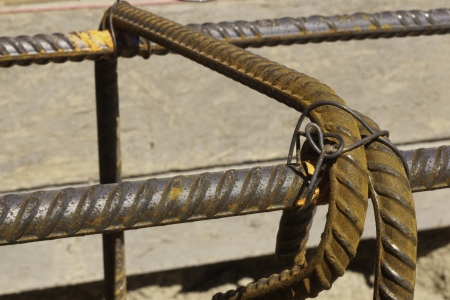 close up of rebar tied with tie wire for construction rusted photo