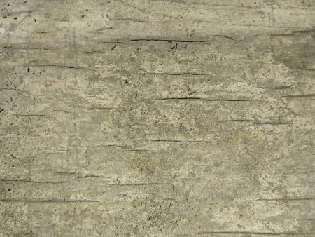 grunge background old cracking wood with concrete stains
