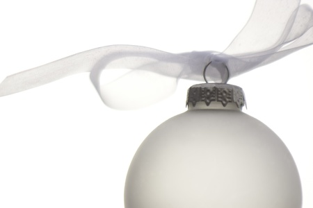 white christmas ornament hanging on a christmas tree Stock Photo