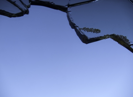 broken glass against a blue sky background photo