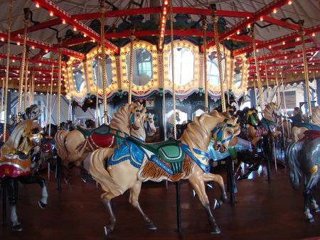 reds: Carrousel at the pier in Santa Monica CA Stock Photo