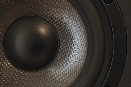 kevlar: Macro   close-up of a bass and mid-tone loudspeaker   studio monitor element in kevlar