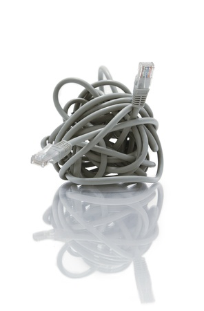 echnology: A macro shot of a tangled network cable  White background and reflections  Stock Photo