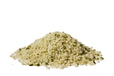 Shelled hemp seeds on white background  Clipping path