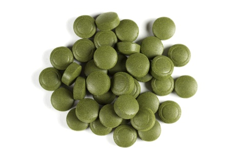 A pile of Chlorella pills  Can be used as background Chlorella is a genus of single-celled green algae and is a complete protein  It is also packed with calories, fat, and vitamins