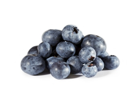 A pile of fresh organic blue berry  Side view on white background  Stock Photo