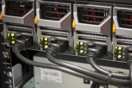 alternating: Power Supplies on blade server in rack  Shot in data center  Stock Photo