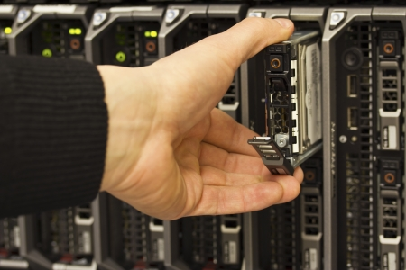 server side: IT technician   consulant insert   remove a harddisk from a blade server data center  This is a 2,5  SAS harddrive