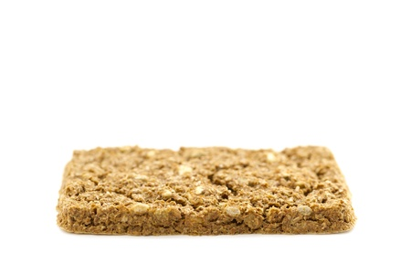 roughage: A crispbread with high content of dietary fiber on white background  Dietary fiber   roughage is not a digestible carbohydrate  Stock Photo