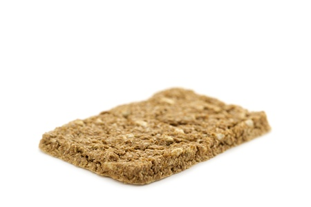 dietary fiber: A crispbread with high content of dietary fiber on white background  Dietary fiber   roughage is not a digestible carbohydrate  Stock Photo