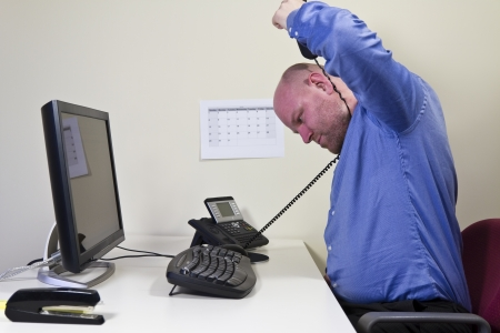 self harm: Self-destructive office worker   businessman try to strangle himself with the telephone cable