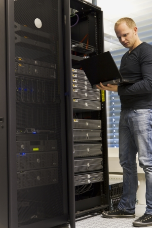 IT Engineer  Consultant monitoring systems and servers in a datacenter  photo