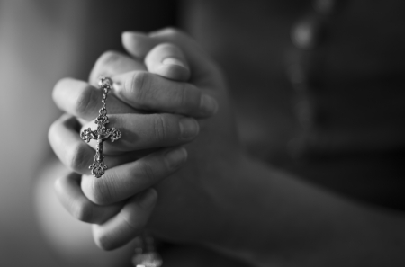 Woman folding hands and praying to God  photo
