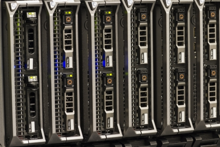 Blade servers in a blade chassis in a rack  Shot in a data center  photo