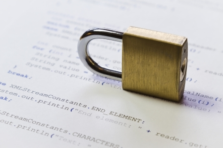 program code: A padlock on Java program code  Symbol of software   application and computer security  High key photo  Can be used as background