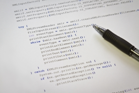 extensible: A programmerg with Java computer code  Software   application program code  XML parser  Stock Photo
