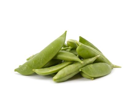 sweet sugar snap: Stack of organic sweet peas on white background