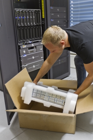 It engineer   consultant install   unpack a server or a network router   switch in a data center