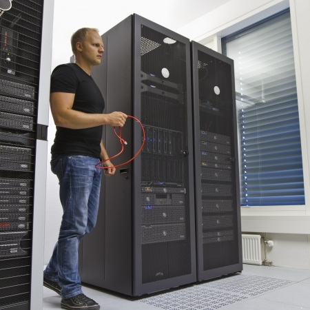 It engineer   consultant working in a data center  Holding a ethernet  Cat 5   6  cable