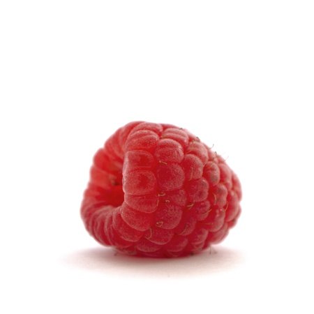 organic raspberry: Side view of a fresh organic raspberry on white background