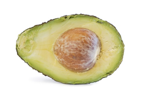 bisected: Side view of a half organic avocado with stone on white background  Stock Photo