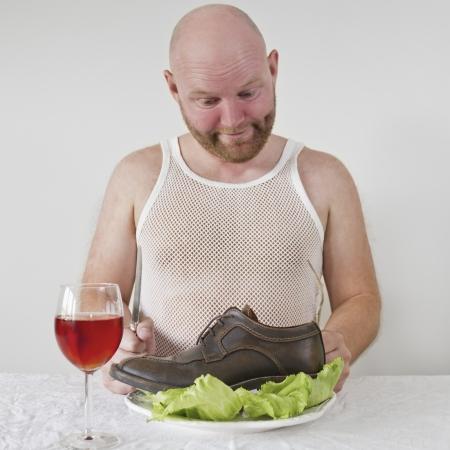 wierd: Wierd man eat his shoes with salad