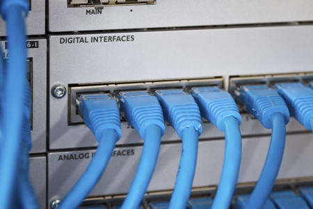 Close up of a cat 5   5e   6 patch cable into a PBX  Private Branch Exchange  switch station for telephone systems Stock Photo - 19198981