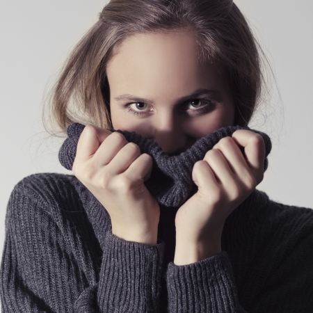 woman sweater: Winter or fall   autumn woman   girl with a turtleneck sweater  Gray background  Toned  Stock Photo