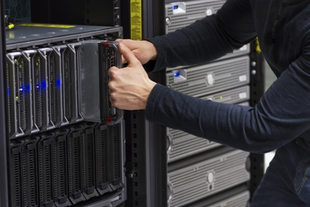 Install or remove a blade server in a blade chassis in a rack  Shot in a data center