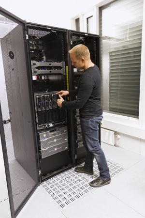 Install or remove a blade server in a blade chassis in a rack  Shot in a data center  photo