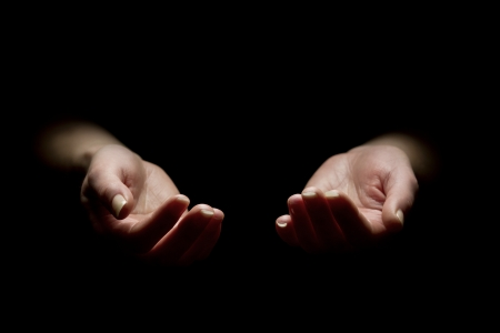 reaching hands: Woman begging with outstretched hands  Hands reaching out  Black and white  Stock Photo