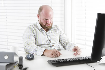 whining: Sad and whining office worker   businessman in the office  To much work and no motivation  Stock Photo