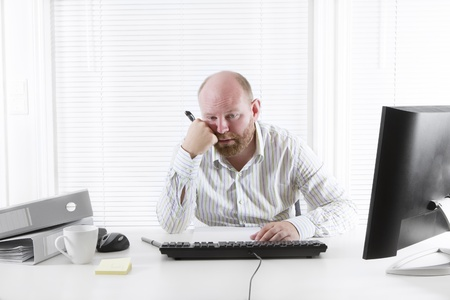 bad color: Exhausted office worker in the office  To much work and no motivation  Stock Photo
