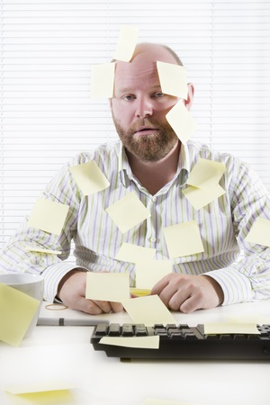 Exhausted and tired office worker in the office  To much work and no motivation  Place your own text on the notes  Stock Photo - 19200043
